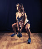 Woman doing kettlebell swings Royalty Free Stock Photos