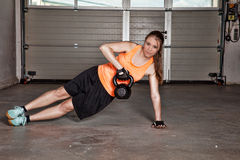 Woman doing kettlebells pull up. In a gym - crossfit royalty free stock photo