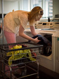 Woman doing laundry. Woman doing the laundry in her home Stock Photos