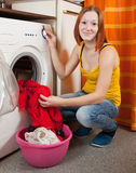 Woman doing laundry Royalty Free Stock Photos