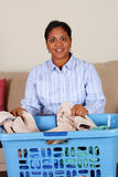 Woman Doing Laundry. Woman doing the laundry in her home Royalty Free Stock Images