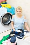 Woman doing laundry in bathroom royalty free stock photo