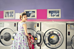 Woman doing the laundry royalty free stock photo