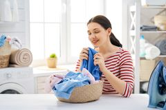 Woman is doing laundry stock photography