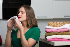 Woman doing laundry Stock Photos