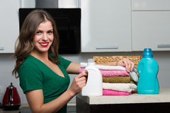 Woman doing laundry Stock Image