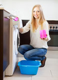 Woman doing laundry with detergent Stock Photo