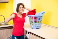The woman doing laundry at home. Woman doing laundry at home royalty free stock image
