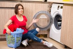The woman doing laundry at home. Woman doing laundry at home royalty free stock photography