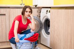 The woman doing laundry at home. Woman doing laundry at home royalty free stock images