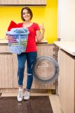 The woman doing laundry at home. Woman doing laundry at home stock images