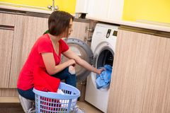 The woman doing laundry at home. Woman doing laundry at home royalty free stock photos