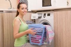 The woman doing laundry at home Stock Image