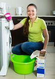 Woman doing laundry at home Stock Photo