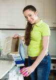 Woman doing laundry at home Stock Photography