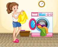 Woman doing laundry at home Royalty Free Stock Photography
