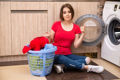 The woman doing laundry at home. Woman doing laundry at home stock image