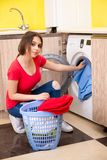 The woman doing laundry at home. Woman doing laundry at home royalty free stock photo