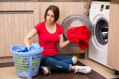 The woman doing laundry at home. Woman doing laundry at home stock photography