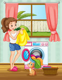 Woman doing laundry in the house Stock Photos