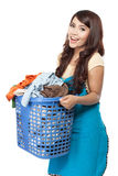 Woman doing laundry. Woman doing a housework holding laundry Stock Photography