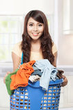 Woman doing laundry. Woman doing a housework holding laundry Royalty Free Stock Photo