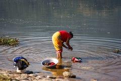 Woman doing laundry on the Phewa Lake, Pokhara, Nepal Stock Photos