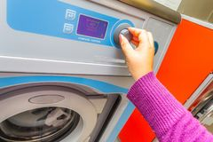 Woman doing laundry. Washing machine stock photos