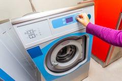 Woman doing laundry. Washing machine stock images