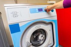 Woman doing laundry. Washing machine stock photography
