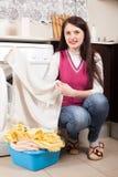 Woman doing laundry with washing machine Royalty Free Stock Image