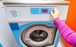 Woman doing laundry. Washing machine royalty free stock photos