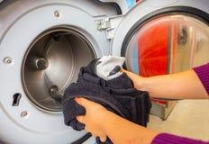 Woman doing laundry. Washing machine royalty free stock photo