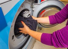 Woman doing laundry. Washing machine royalty free stock photography