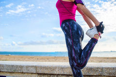 Woman doing leg stretching exercises Royalty Free Stock Photography