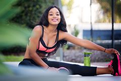 Woman Doing Leg Stretching While Sitting royalty free stock photography