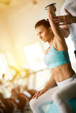 Woman doing  lifting dumbbells exercises Royalty Free Stock Photos