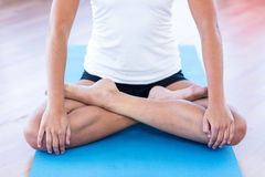 Woman doing lotus posture Stock Photo