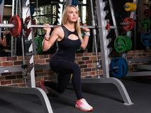 Woman doing lunge squats Royalty Free Stock Photography