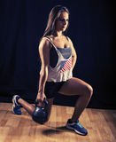 Woman doing lunges with kettlebell Royalty Free Stock Image
