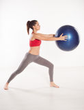 Woman doing lunging exercises Stock Image