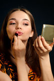 Woman doing make-up Royalty Free Stock Images