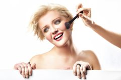 Woman doing make up Stock Image