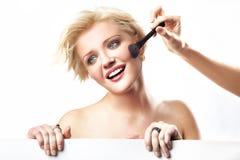 Woman doing make up Stock Image