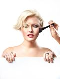 Woman doing make up Royalty Free Stock Image