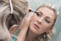 Woman doing make-up Stock Photo