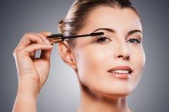 Woman doing make-up. Royalty Free Stock Photo