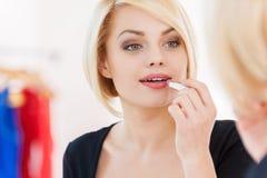 Woman doing make-up. Stock Image