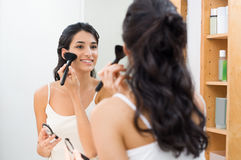 Woman doing make up Stock Images