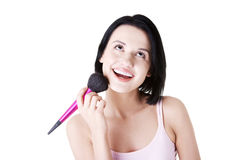 Woman doing make-up on face. Royalty Free Stock Photo